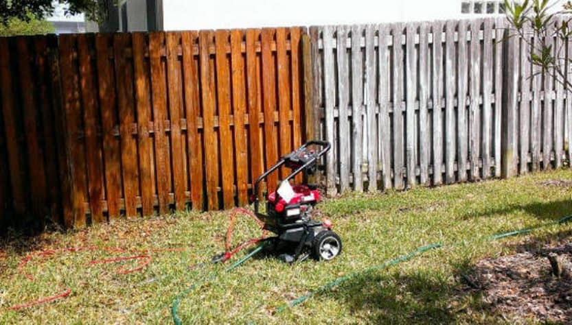 Pressure wash clean your fence
